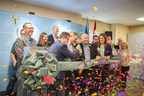 Sundial CEO, Torsten Kuenzlen surrounded by his board, executives and elected officials cutting the ribbon to mark the opening of the company's flagship facility in Olds, Alberta. (CNW Group/Sundial Growers)
