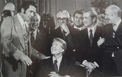 Ken Blaylock, far left, who served as national president of the American Federation of Government Employees from 1976-1988, was instrumental in getting landmark legislation signed into law by President Carter in 1978 that expanded collective bargaining rights for federal employees. He died Oct. 10.