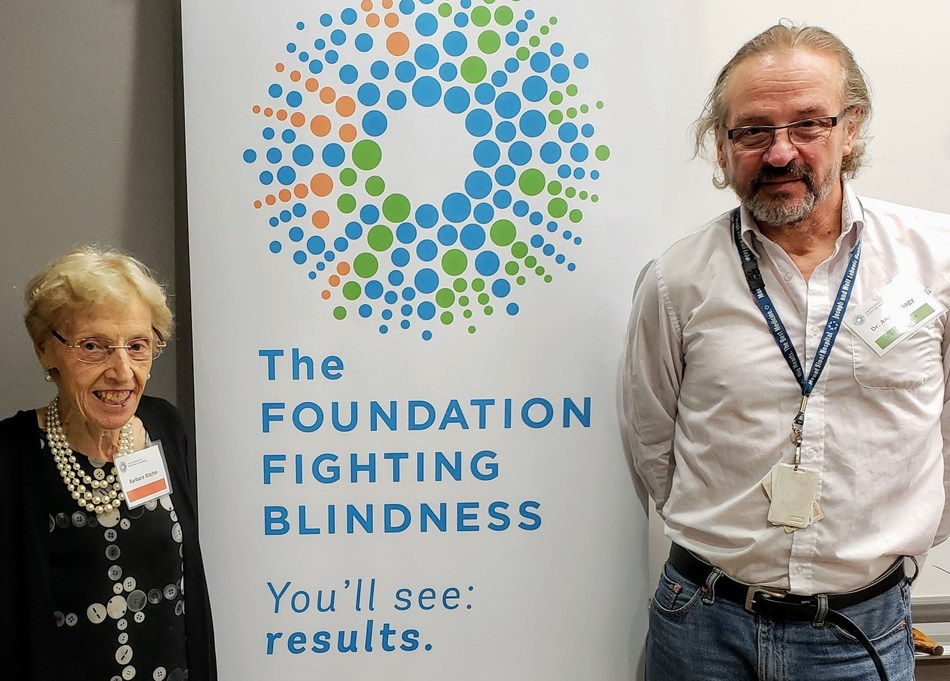 Barbara Ritchie and Dr. Andras Nagy at his lab during a recent tour. (PRNewsfoto/The Foundation Fighting Blindne)