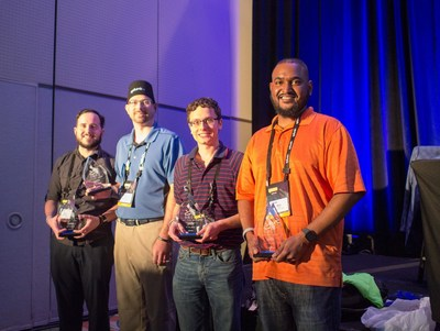 The Hurricane Labs Team (left to right) Steve McMaster, Tim Baldwin, Tom Kopchak, and Mark Mague are all smiles as they accept the first-place trophies awarded after 5 hours of competitive problem-solving with Splunk.