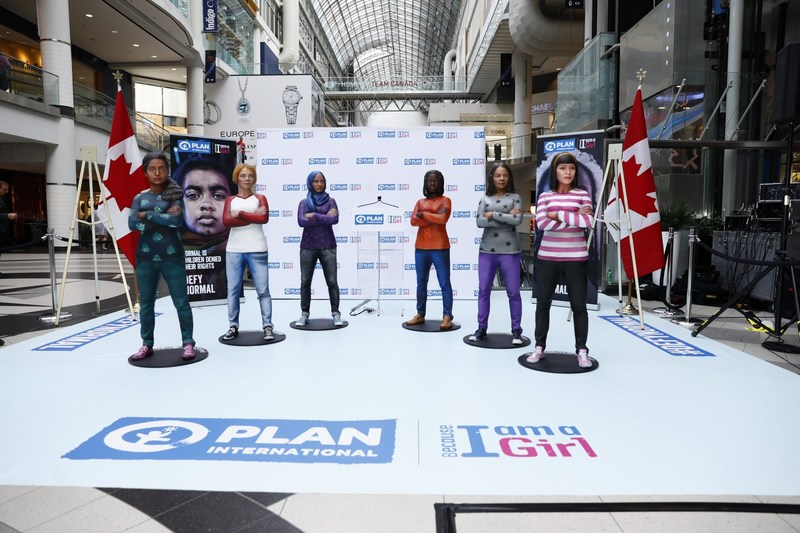 Six diverse girl statues created by global child rights and gender equality organization, Plan International Canada, stand in defiant poses at CF Toronto Eaton Centre on International Day of the Girl, representing girls fighting for gender equality around the world. (Josh Fee/Plan International Canada) (CNW Group/Plan International Canada)