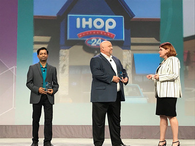 Charlie Jones, Dine Brands Global, and Amrit Raj, XCentium, accept the Ultimate Sitecore Experience Award for the Americas from Paige O'Neill, Chief Marketing Officer, Sitecore.