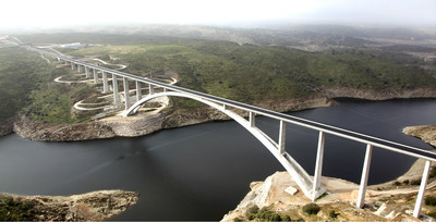 Viaduct Over River Almonte in Garrovillas de Alconétar, Cáceres, Extremadura, Spain– the 2018 ACI Excellence in Concrete Construction Award winner. The viaduct's 384 m (1260 ft) main span makes it the largest railway bridge in Spain and the world's largest concrete arch bridge for high-speed rail service.  The ACI Excellence in Concrete Construction Awards were created to honor the visions of the most creative projects in the concrete industry.