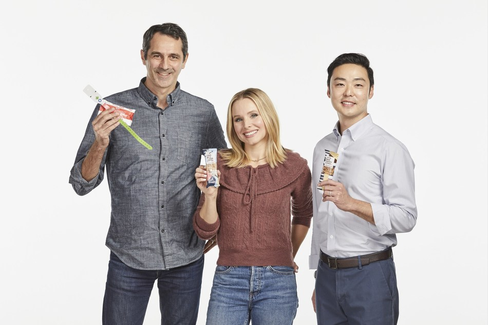 Social impact brand This Bar Saves Lives, LLC announced that it is the first company to partner with Action Against Hunger to pilot a new model for dealing with severe acute malnutrition – one that empowers customers to give food aid with every better-for-you snack bar they buy.  From left to right: Andrea Tamburini [CEO, Action Against Hunger], Kristen Bell [Co-Founder, This Bar Saves Lives; Actor], Paul Yoo [CEO, This Bar Saves Lives].
