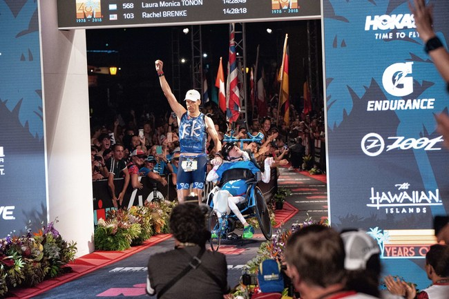 Kyle and Brent Pease crossing the finish line at the IRONMAN World Championship, becoming the first push-assisted team of brothers to complete the race. Photo Credit: John David Johnson.