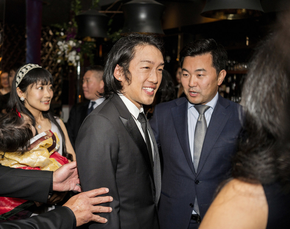 Crown Prince Andrew Lee, left, greets L.A. city and county officials, including L.A. Councilman David Ryu, right, at the Passing of the Sword ceremony.