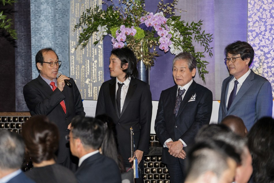 Wonsuk University Chancellor Young-dal Chang, left, and South Korean Congressman Kwang-soo Kim, right, congratulated Crown Prince Andrew Lee and Crown Prince Yi Seok, center, during a Passing of the Sword ceremony inside Crustacean Beverly Hills on Oct. 6, 2018.