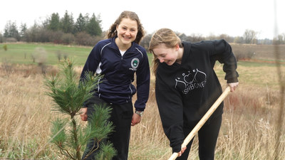 Two Grade Nine Students Help with the Tree Planting in April of 2018. [Photo Credit: Zach Lawton] (CNW Group/Forests Ontario)