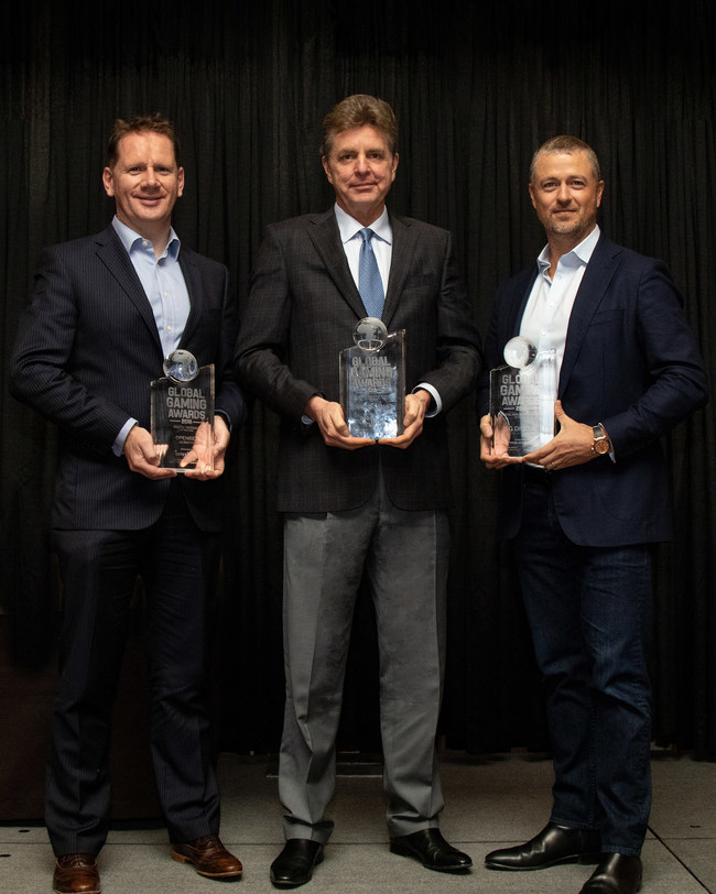 Scientific Games Executive Vice President of Sports Keith O'Loughlin, Group Chief Executive of Lottery Jim Kennedy and Group Chief Executive of Digital Matt Davey proudly display three Global Gaming Awards the Company received at the Global Gaming Expo in Las Vegas.