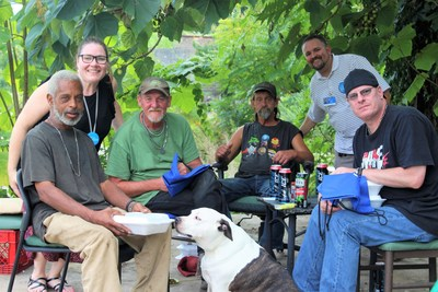 The Gardens at West Shore's Kristia Colon and Bryan Molina pose with a group of meal recipients in Harrisburg, Pa.