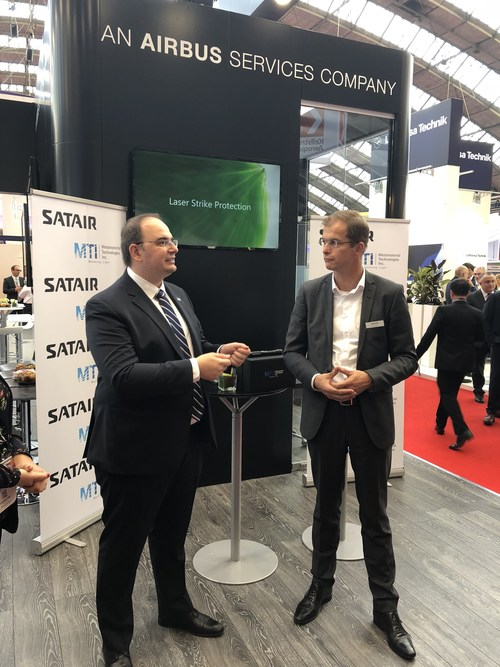 Bart Reijnen, CEO Satair and George Palikaras, Founder and CEO MTI sign distribution agreement at MRO Europe. (CNW Group/Metamaterial Technologies Inc.)