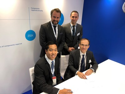 AAR's Eric Young, Senior Vice President, OEM Solutions (seated left) and Martin Adnoff, Vice President, Business Development, OEM Solutions, Europe, (standing left) with Zodiac Aerospace Services CEO Bruno Delile (seated right) and Roman Calvo, Product and Marketing Manager, at the signing ceremony Wednesday during MRO Europe, RAI Amsterdam, the Netherlands.