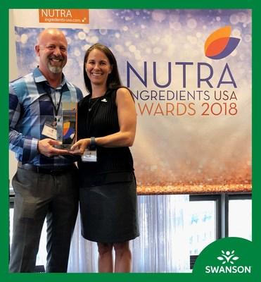 Swanson Health's Chief Innovation Officer, Shane Durkee and Director of Science and Innovation, Amy Sunderman accept the NutraIngredients-USA Omega-3 of the Year Award.
