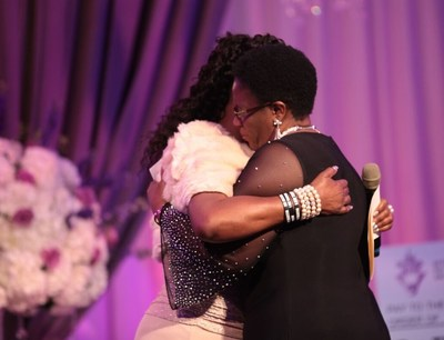 Trayvon Martin's mother, Sybrina Fulton, embraces Botham Jean's mother, Allison Jean, during the God's Leading Ladies gala in Dallas.