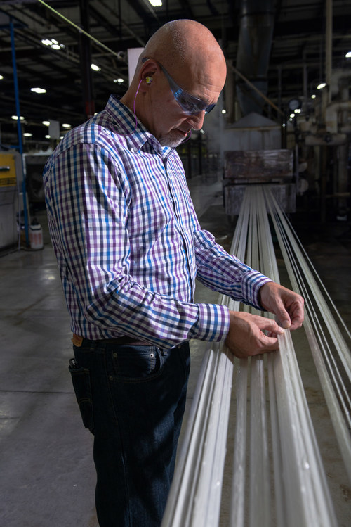 PrimaLoft product development engineer interacting with PrimaLoft® Bio during initial fiber run at production facility.