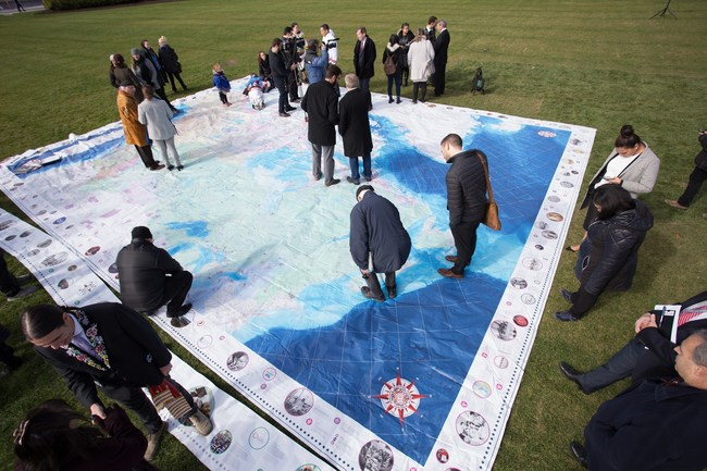 Dignitaries share stories on Indigenous Peoples Atlas of Canada's Giant Floor Map at  the launch of the educational materials on Parliament Hill launch in Ottawa. (CNW Group/Royal Canadian Geographical Society)