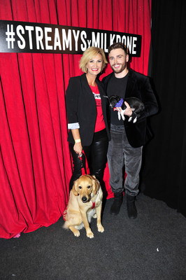 Passionate dog lover, Olympic Silver Medalist and freestyle skier, Gus Kenworthy, poses with the Milk-Bone® Dog of the Year Honor winner, Todd the Hero Dog, at the 2018 Streamy Awards.