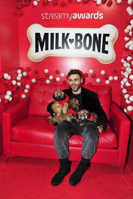 Passionate dog lover, Olympic Silver Medalist and freestyle skier, Gus Kenworthy, plays with puppies at the Milk-Bone® Puppy Playpen at the 2018 Streamy Awards.