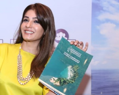 Raveena Tandon displays Dominica's Citizenship by Investment brochure (PRNewsfoto/CS Global Partners)