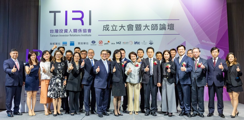 Honored guests and executive committee members celebrate the chartering of TIRI.
