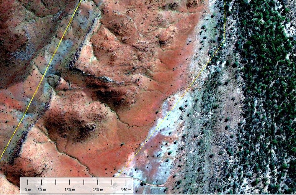 Figure 5. 300 m wide erosional edge and talus slope falling away from the Mount Roe high area in upper left of air photo. (CNW Group/Pacton Gold Inc.)