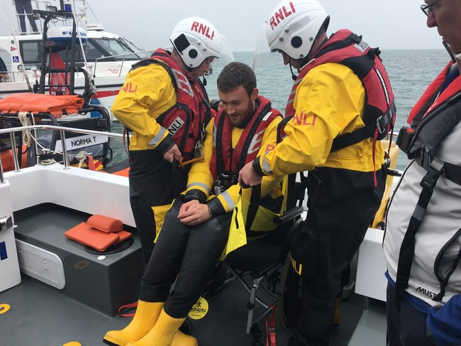 Rescuers using ADAPTS portable transfer sling during an evacuation drill at sea. ADAPTS is launching #WhyWait, an awareness campaign to highlight why it is necessary for people with disabilities to have a disaster plan for emergencies at home or while traveling.