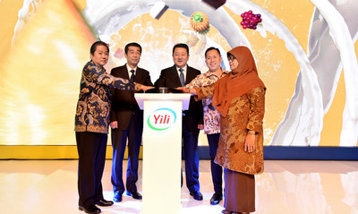 Attendees celebrate the launch of 11 new ice-cream products by Yili Group at a press conference held in Jakarta, Indonesia on Oct 23.