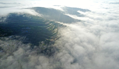 Clouds flow upon the terrace fields after rain in the Jingning County in Pingliang City, Gansu Province.