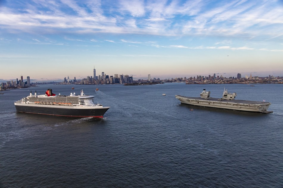 Cunard's flagship ocean liner Queen Mary 2 greets the Royal Navy aircraft carrier HMS Queen Elizabeth in the New York Harbor, Thursday, Oct. 25, 2018, during the carrier's first visit to the U.S. (Jonathan Atkin for Cunard)