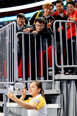 Rui Wang from China women's team was taking selfies with the fans