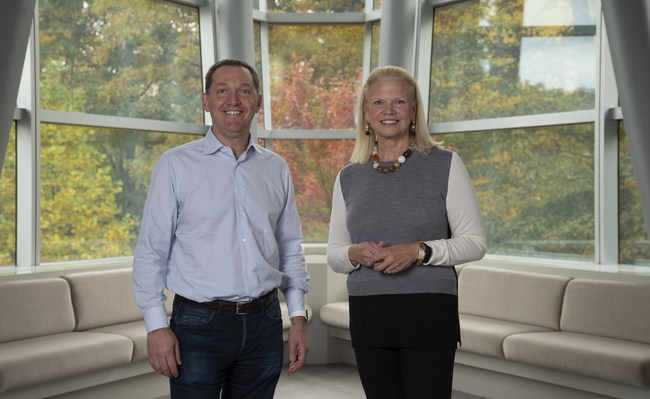 Ginni Rometty, Chairman, President, and CEO of IBM, at right, and James M. Whitehurst, CEO of Red Hat, left, announced, Sunday, October 28, 2018, Armonk NY,  that the companies have reached a definitive agreement under which IBM will acquire all of the issued and outstanding common shares of Red Hat for $190.00 per share in cash, representing a total enterprise value of approximately $34 billion. This acquisition brings together the best-in-class hybrid cloud providers and will enable companies to securely move all business applications to the cloud. (Feature Photo Service)