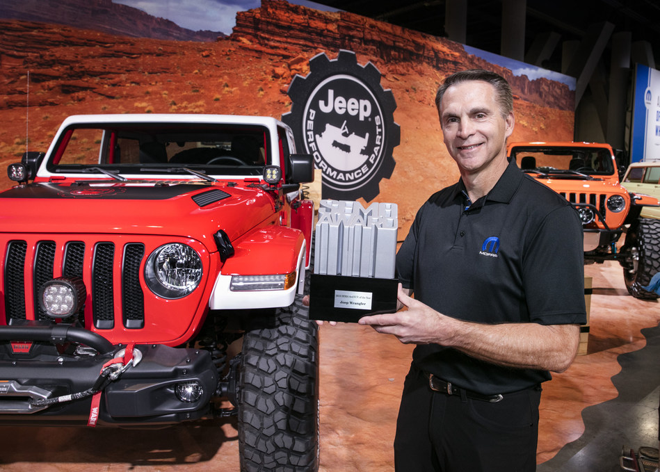 """Steve Beahm, Head of Parts & Service (Mopar) and Passenger Car Brands, FCA - North America, celebrates with the Specialty Equipment Market Association (SEMA) Show """"4x4/SUV of the Year"""" award, captured by the Jeep® Wrangler for the ninth consecutive year."""