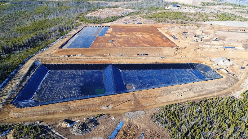 Liners for Water Management Ponds completed, with Tailings Waste Storage Facility in background (CNW Group/eCobalt Solutions Inc.)