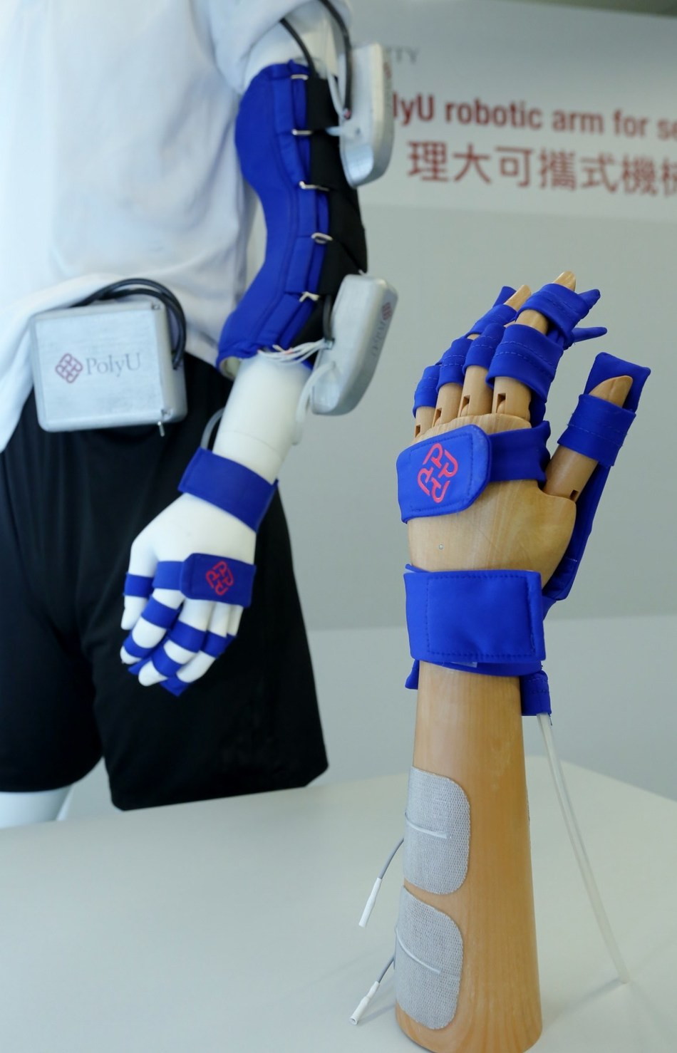 The PolyU-developed robotic arm is the first-of-its-kind integration of exo-skeleton, soft robot and exo-nerve stimulation technologies. It is light in weight, compact in size, fast in response and demands minimal power supply, thus suitable for use in both indoor and outdoor environment. (PRNewsfoto/PolyU)