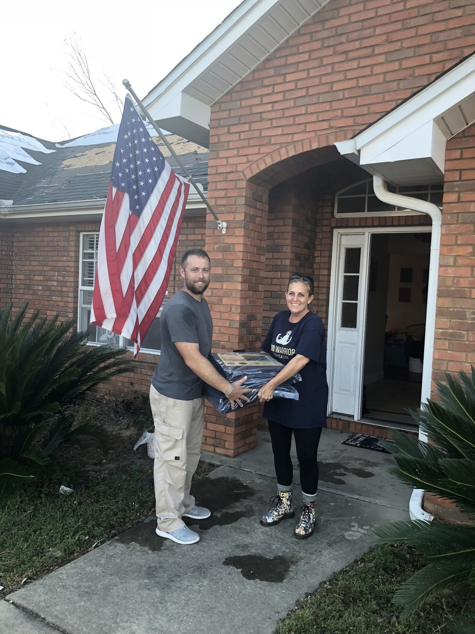 Brian Hood, Army EOD National Guard and Kellie Perry, EODWF Board member work together to deliver tarps and other supplies to EOD families during Hurricane Michael relief efforts.