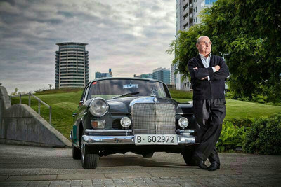 Carey Madrid owner Blai Matons poses with the original 1965 Mercedes that he used to start his business.