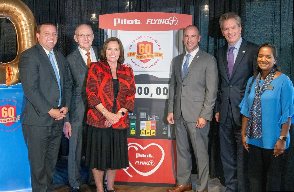 In celebration of its 60th anniversary, Pilot Flying J announced donations totaling $2 million at a Nov. 1 presentation at the company's HQ in Knoxville.  More than 20 nonprofit organizations will receive contributions. Pictured from left: Bart McFadden (Boys & Girls Clubs); Pilot Flying J Founder James A. Haslam II; Elaine Streno (Second Harvest Food Bank of East Tennessee); Nathan Smith (Hire Heroes USA); Andy Wilson (Feeding America); and Meg Counts (Pilot Flying J).