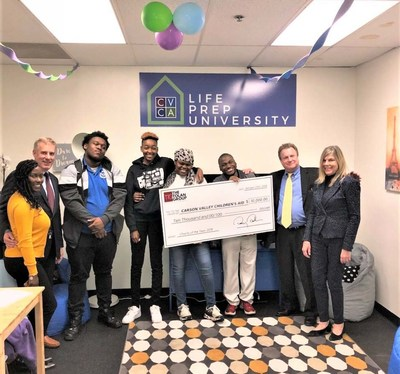 The Tolan Group donates $10,000 to Life Prep University. From left: Quanda Reynold, Mason Harris, Darius Cullen, Dayiveion Burton, Jackwana Ladson, Dayshawn Jackson, Tim Tolan, and Diane Kiddy.