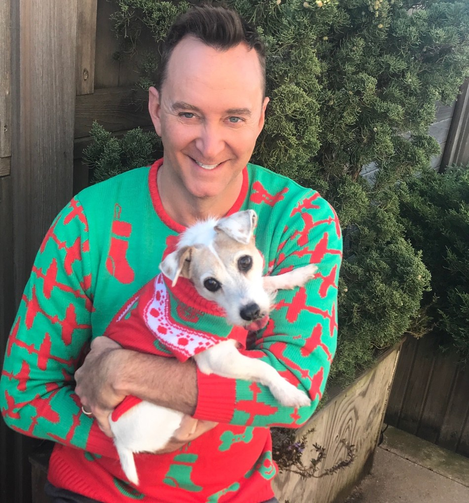 Clinton Kelly and his dog Mary partner with the CESAR® brand to show off their Twinning holiday sweaters.