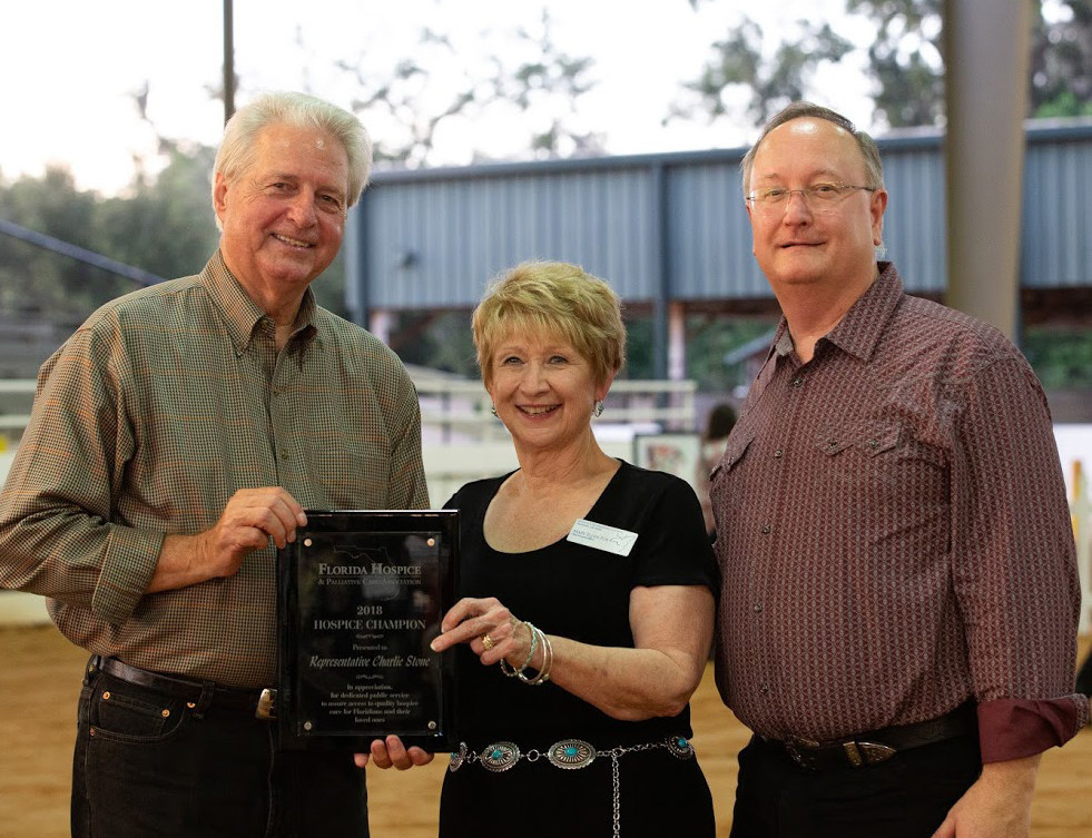 Rep. Charlie Stone (FL-22nd District) received the Hospice Champion award from Paul A. Ledford, President and CEO, Florida Hospices & Palliative Care Association. Hospice of Marion County CEO Mary Ellen Poe joined in the presentation at the Uptown Hoedown gala fundraiser event in Ocala on October 18, 2018.