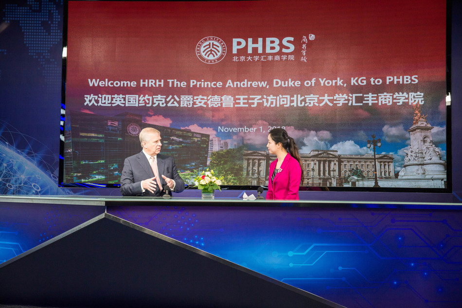 HRH The Duke of York speaks to a student in the laboratory on pushing forward innovation and entrepreneurship, and enhancement of Sino-UK education