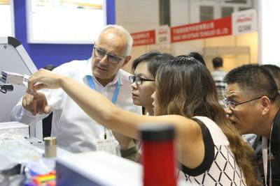 Visitors viewing an exhibit (PRNewsfoto/Medtec China)