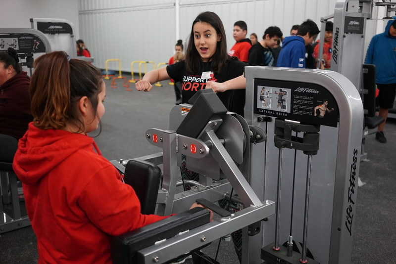 Moosonee teens took part in a youth night at the new community gym to learn how to use the fitness equipment and work with experts from GoodLife to plan their own workout programs. (CNW Group/GoodLife Fitness)