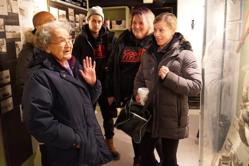 Cree elder Dorothy Wynne describes some traditional Cree tools and implements to GoodLife Fitness associates as part of historic tour of Moosonee. (CNW Group/GoodLife Fitness)