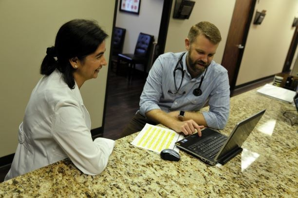 Dr. Silvers, the head of our OIT program, and Dr. Wahid, our new Houston area physician, going over treatment options.
