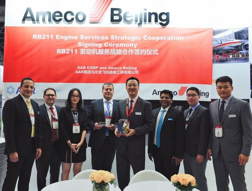 Sal Marino, Senior Vice President Aviation Services, for AAR, (center, left) with Bin Teng, General Manager of Marketing and Sales, Ameco, (center, right) at the signing ceremony at MRO Asia-Pacific in Singapore.