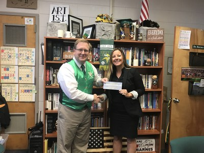 L-R White Oak High School Principal, Chris Barnes, accepts a donation check from Hunt Heroes Foundation Board Member, Clara Abalos.