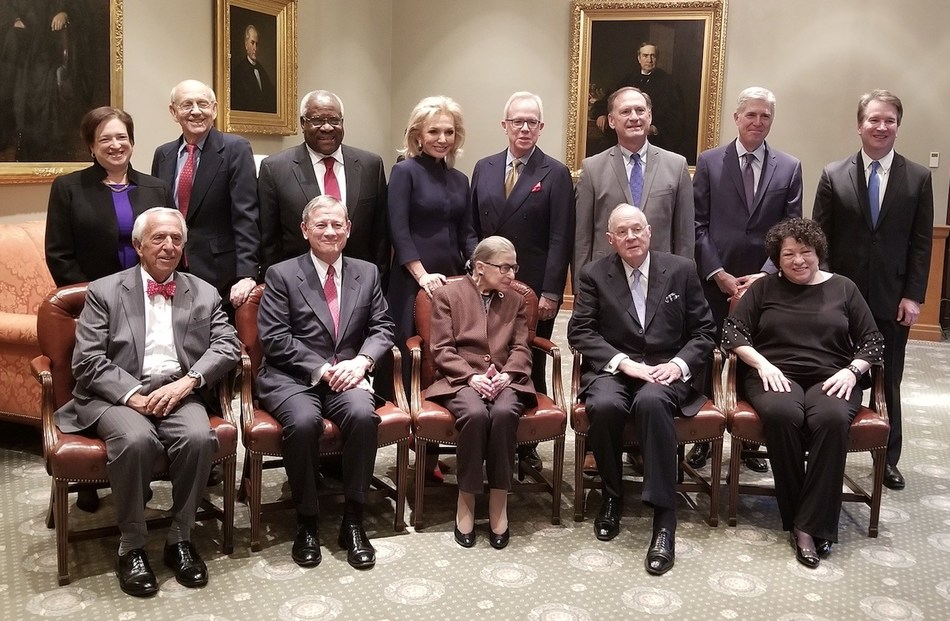 From L-R, Standing: Justice Elena Kagan, Justice Stephen Breyer, Justice Clarence Thomas, Julie C. Opperman, Robert Newlen, Justice Samuel Alito, Jr., Justice Neil Gorsuch, Justice Brett Kavanaugh.  Sitting: Judge Charles Breyer (2018 Devitt Award recipient), Chief Justice John G. Roberts, Jr., Justice Ruth Bader Ginsburg, Justice Anthony Kennedy, Ret., Justice Sonia Sotomayor; Source: Dwight D. Opperman Foundation