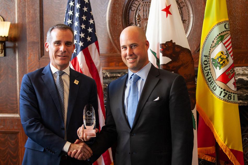 Mayor Eric Garcetti accepts Connected City Award from Mobilitie EVP Jason Caliento