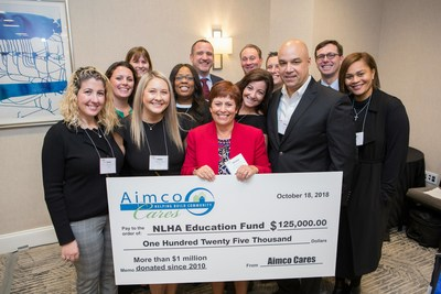 Aimco teammates in Washington D.C. are joined by Aimco Cares golf tournament sponsors Brian Russell of Apartments.com and Al Cissel of ARA to present $125,000 to the National Leased Housing Association.